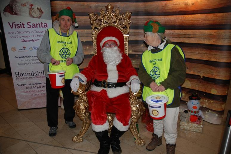 SANTA VISITS THE HOUNDSHILL CENTRE, BLACKPOOL - Santa with Ian and Lilian, North West Air Ambulance members.