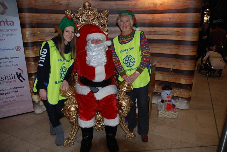 SANTA VISITS THE HOUNDSHILL CENTRE, BLACKPOOL - Santa with Esther and Brenda from the RNLI (Blackpool Lifeboats).