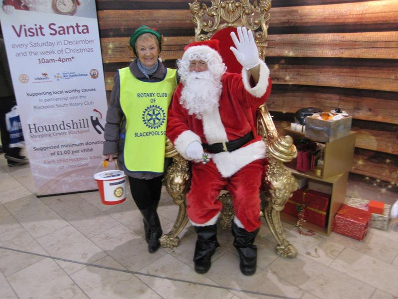 SANTA VISITS THE HOUNDSHILL CENTRE, BLACKPOOL - Santa and his little helper.