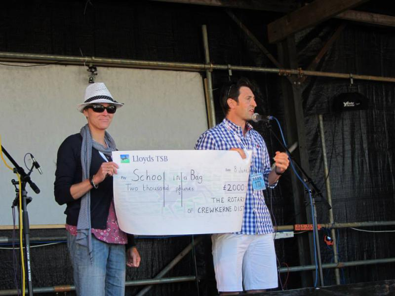 Fund Raising - Funds totalling £2000 raised 2012/13 presented on stage at Home Farm Fest