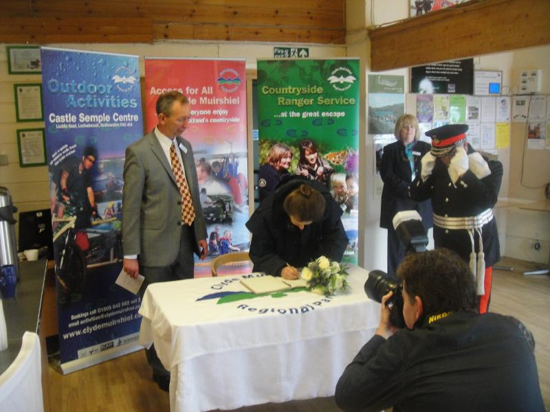 Princess Royal Visits Castle Semple - Signing the visitors book.