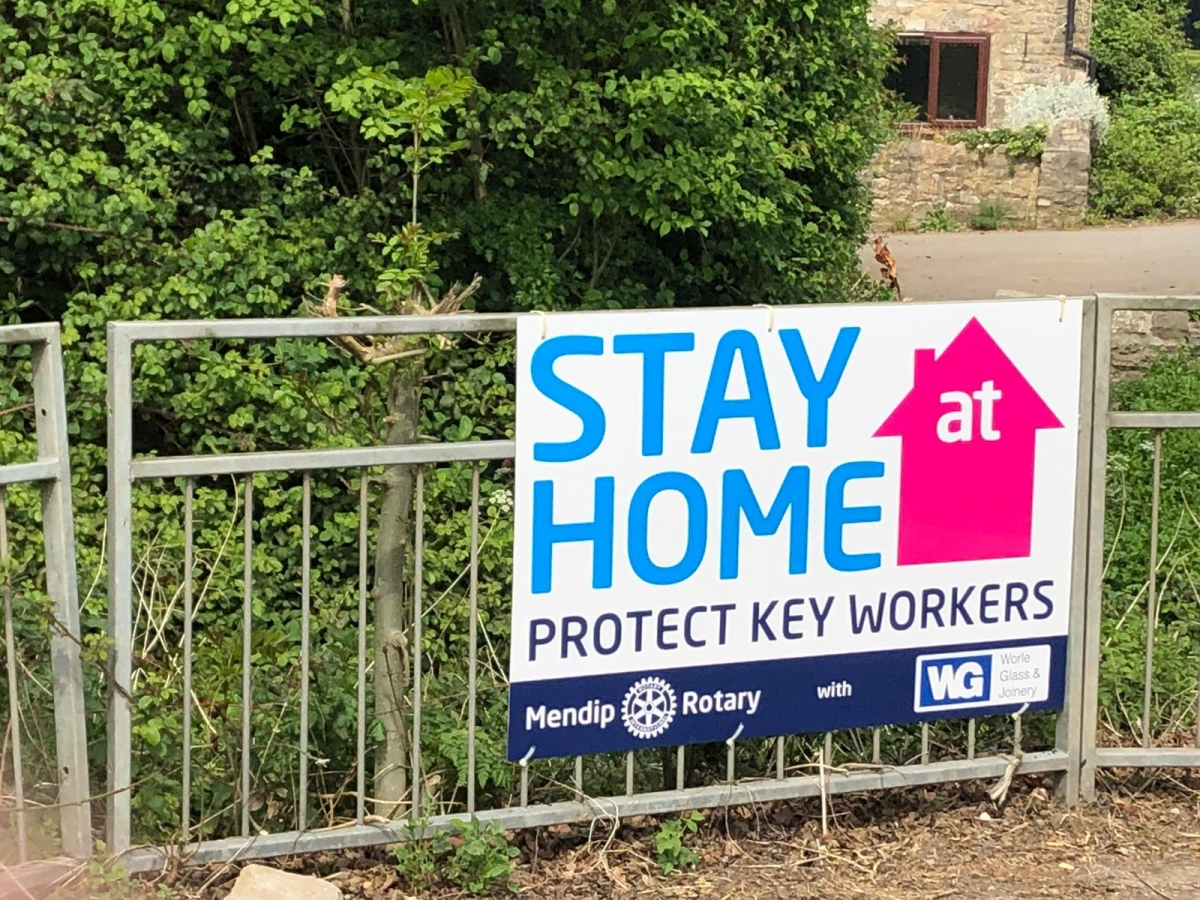The Club erect Stay at Home signs - Thanks to Worle Glass & Joinery