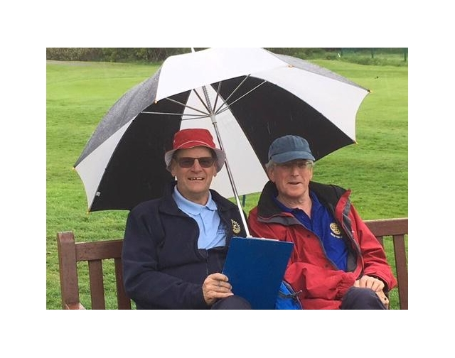 Rotary Club of Newton Abbot Golf Day - Stover - Rotarians Keith Smith & Chris Pegg - helping