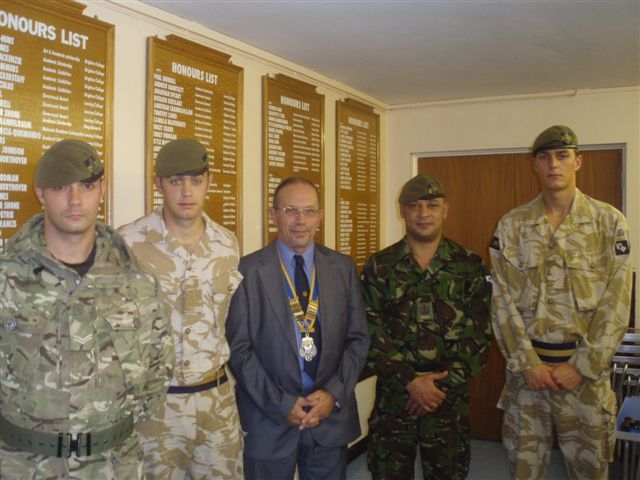 More about what we do - Soldiers with Worthing Rotary Club President John Rogers