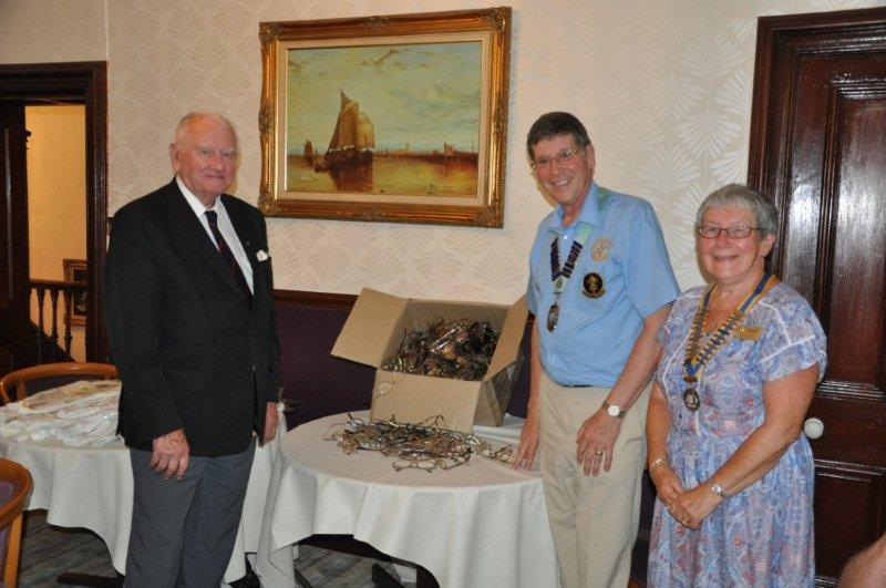 District Governor's Visit - 2014-2015 DG Roger Mason and President Hazel congratulate Arthur on the collection.