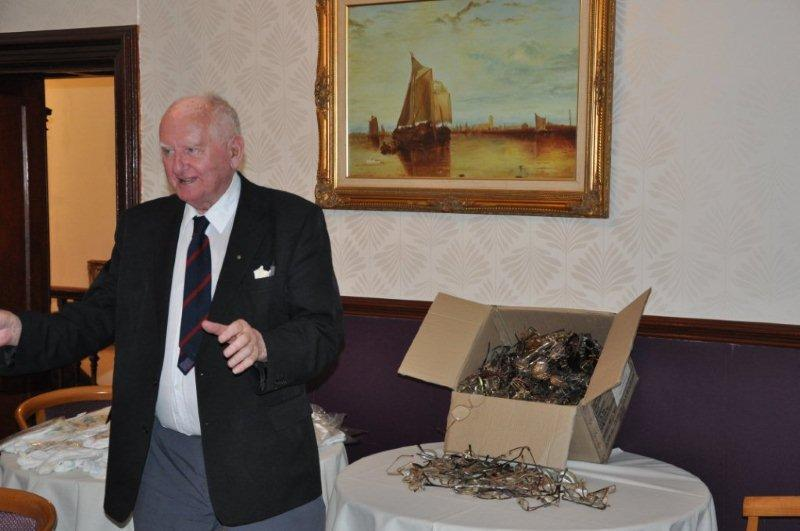 District Governor's Visit - Arthur explains how the spectacle recycling for Vision Aid Overseas works.