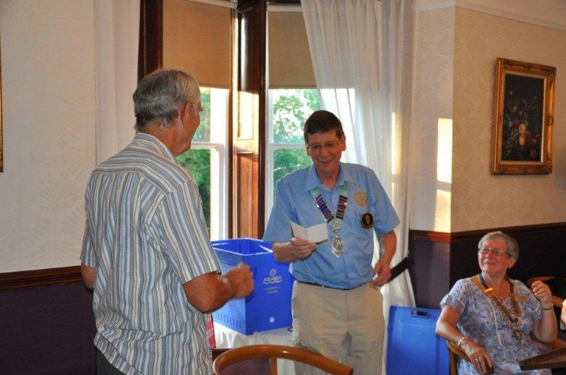 District Governor's Visit - International Service Chairman Keith presents DG Roger with a cheque for two Aquaboxes.