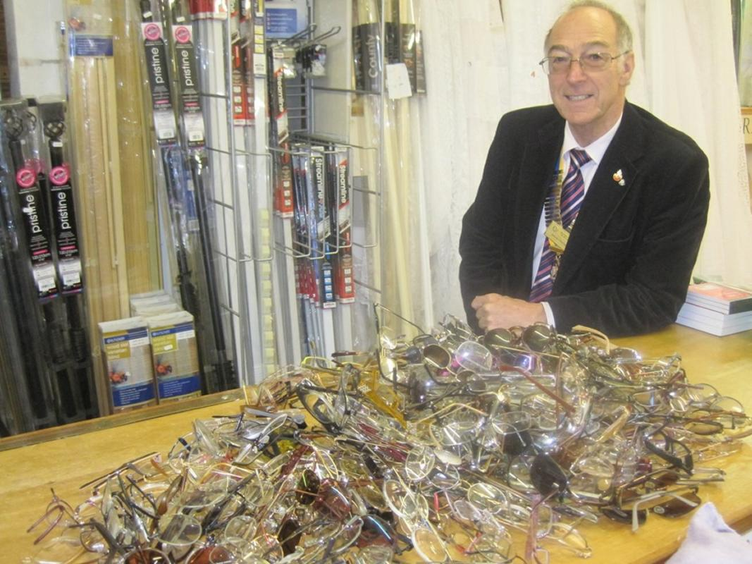 Spectacles Collection - President David with the spectacles ready to be sent to Vision Aid overseas