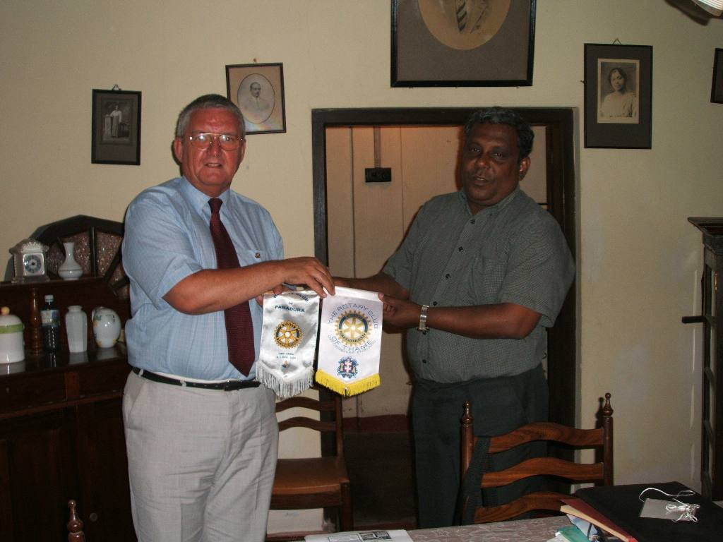 Tsunami Disaster - 1 year on (2006) - Visit to Rotary Club Panadura - exchanging pennants with the Club President