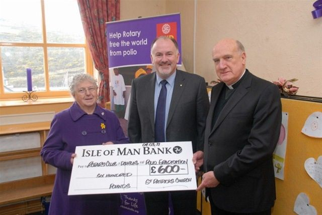 End Polio Now - Rotarian Kevin Kneen receiving a cheque for