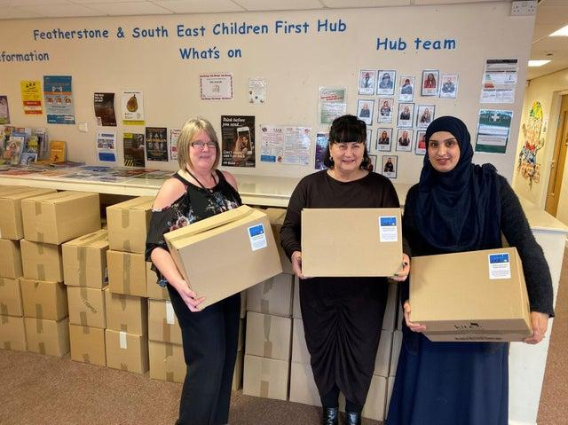 Christmas Hamper Appeal 2020 - Staff at the Featherstone and South East Children First Hub with packed hampers in 2019