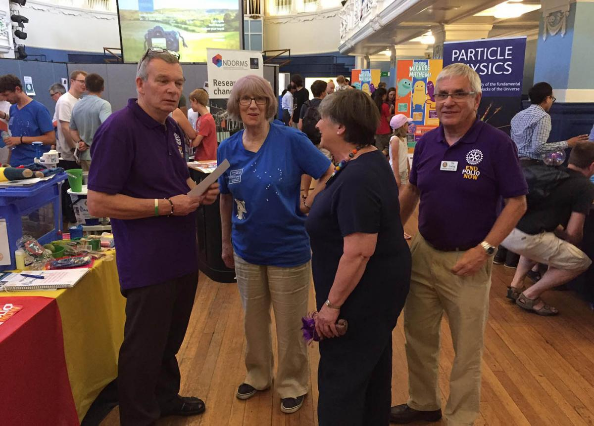 Turning Purple for Polio at Oxfordshire Science Festival - As the numerous exhibitors put the final touches to their stands in the packed Hall, Team Rotary has a final briefing