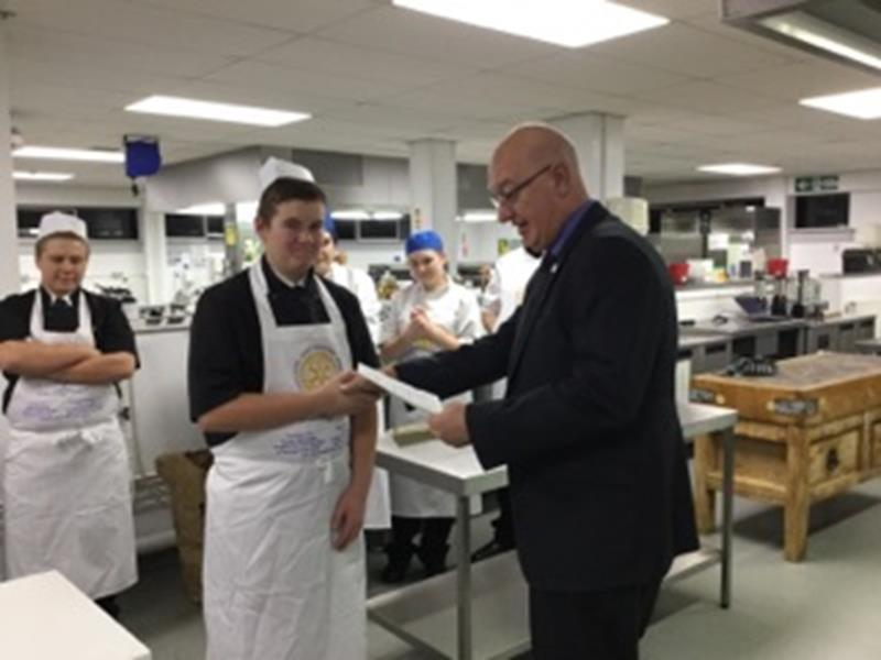 Rotary Young Chef - Trinity President Jim Milne presents the winning certificate