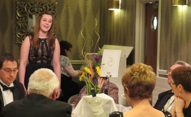 10th Anniversary Charter Dinner - Jessica Edom. District Young Musician Voice winner National Finalist entertaining the diners over coffee