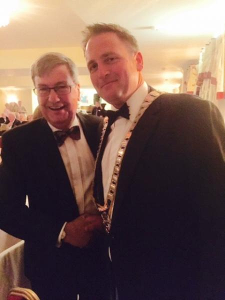 May Ball - New member Mike Timson tries on the chain for size