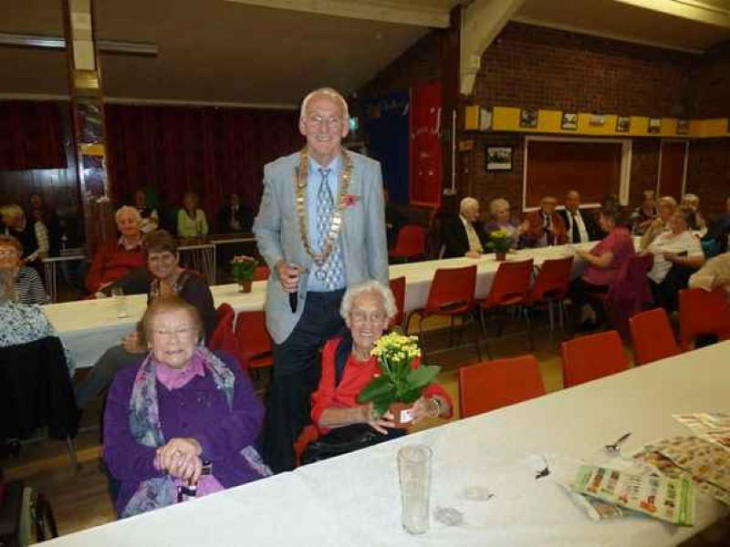 Harvest Supper 2013 - The oldest guest  receives her plant