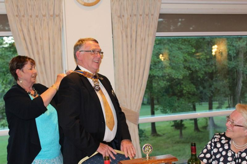 Ross Rotary Club Handover Dinner - Tina strangling the new president