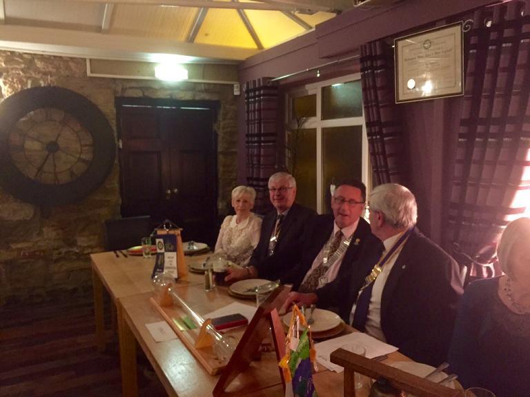 Club 25th Anniversary Meeting - DG Terry and President Dave Neville discuss Rotary issues watched over by President Mick Drake and Anne