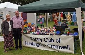 EVENTS IN JULY 2017 - Here we see  Rotarians Bryan and Helen Swain in front of their stall where Helen was selling knitted toys.  She raised £50 towards Kids Out.