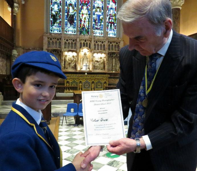 RIBI YOUNG PHOTOGRAPHER COMPETITION - Victor Ghose receiving his District 1130 Winner's Certificate for the Junior Category of the District Level Young Photographer Competition signed by District Governor David Palmer