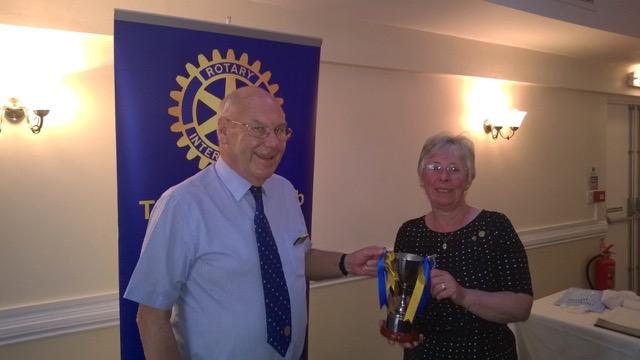 HANDOVER 2015 - Outgoing President Max presents Rotarian of the Year to Anna Morgan Crocket