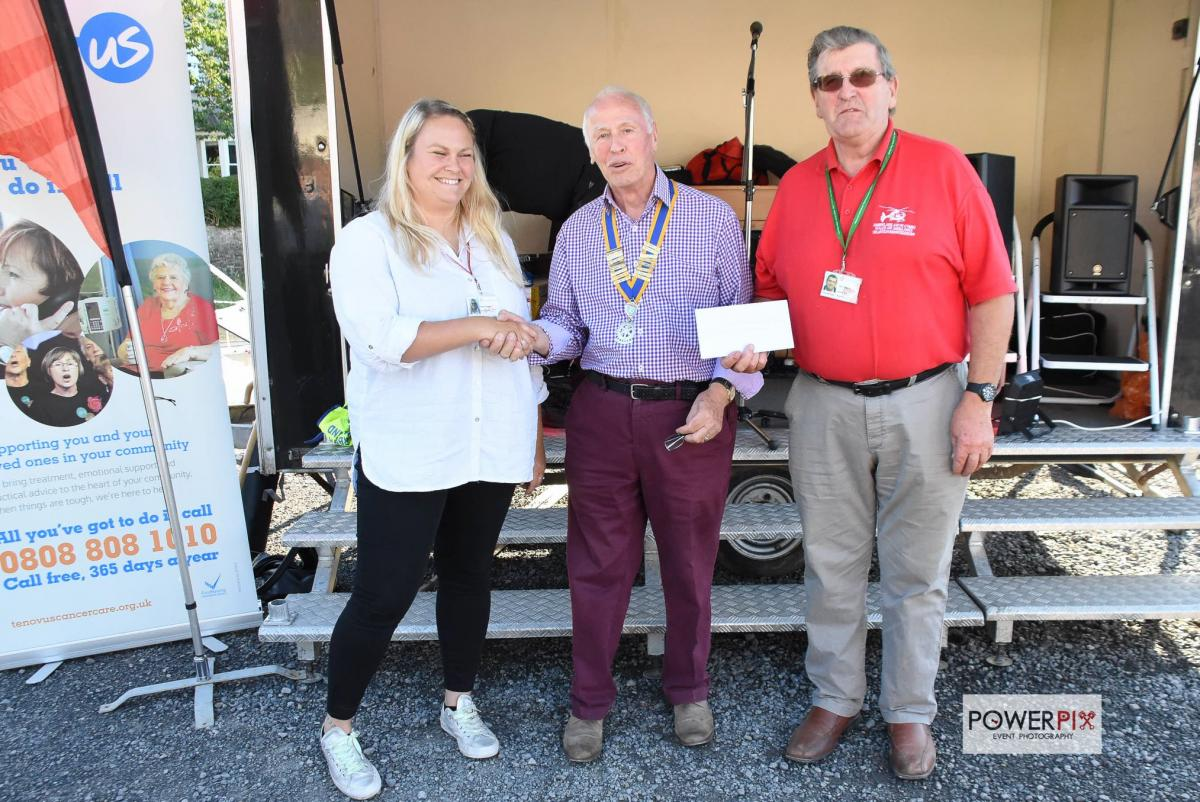 Thanks from the Wales Air Ambulance - Katie Thomas and Rhys Walkin from the Wales Air Ambulance receive their cheque from Narberth and Whitland Rotary Club President Tony Ensom