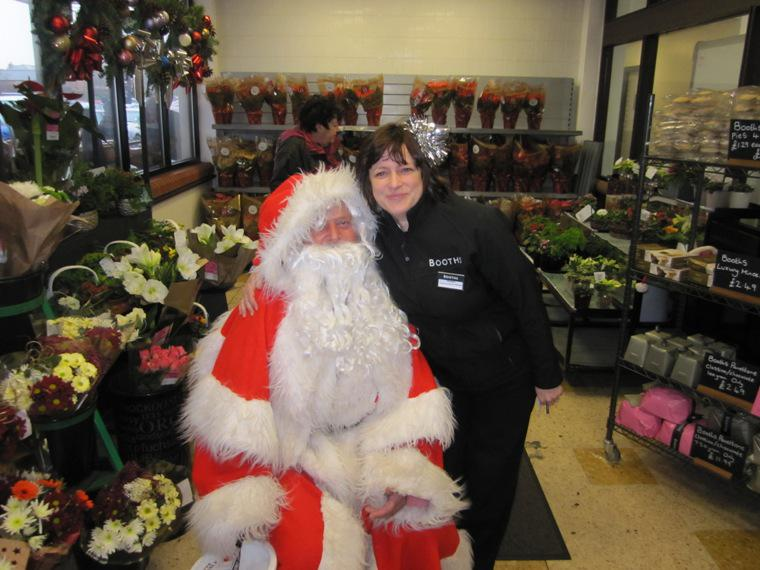 SANTA AND THE MUSICAL SANTA SLEIGH VISITS THE MARTON BOOTHS STORE  - But we think Helen prefers to cuddle Santa. He might bring her something nice.