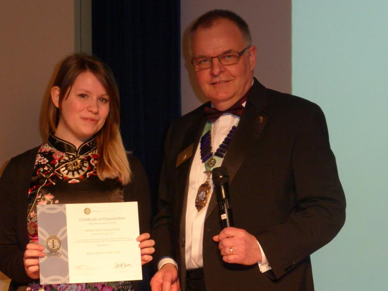 Interact Clubs in Cumbria & Lancashire - DG Kevin Walsh presents the Charter to President Mikaela Dawson