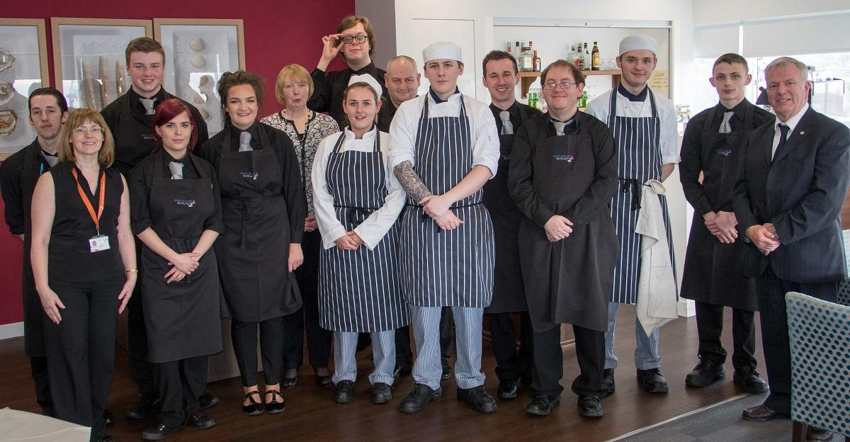World's Greatest Meal and Surprise for Rtn. John Paul - Rtn. Bill Dempster, who organised the event, with President Loraine and  the staff and students who prepared and served the delicious meal at the event.