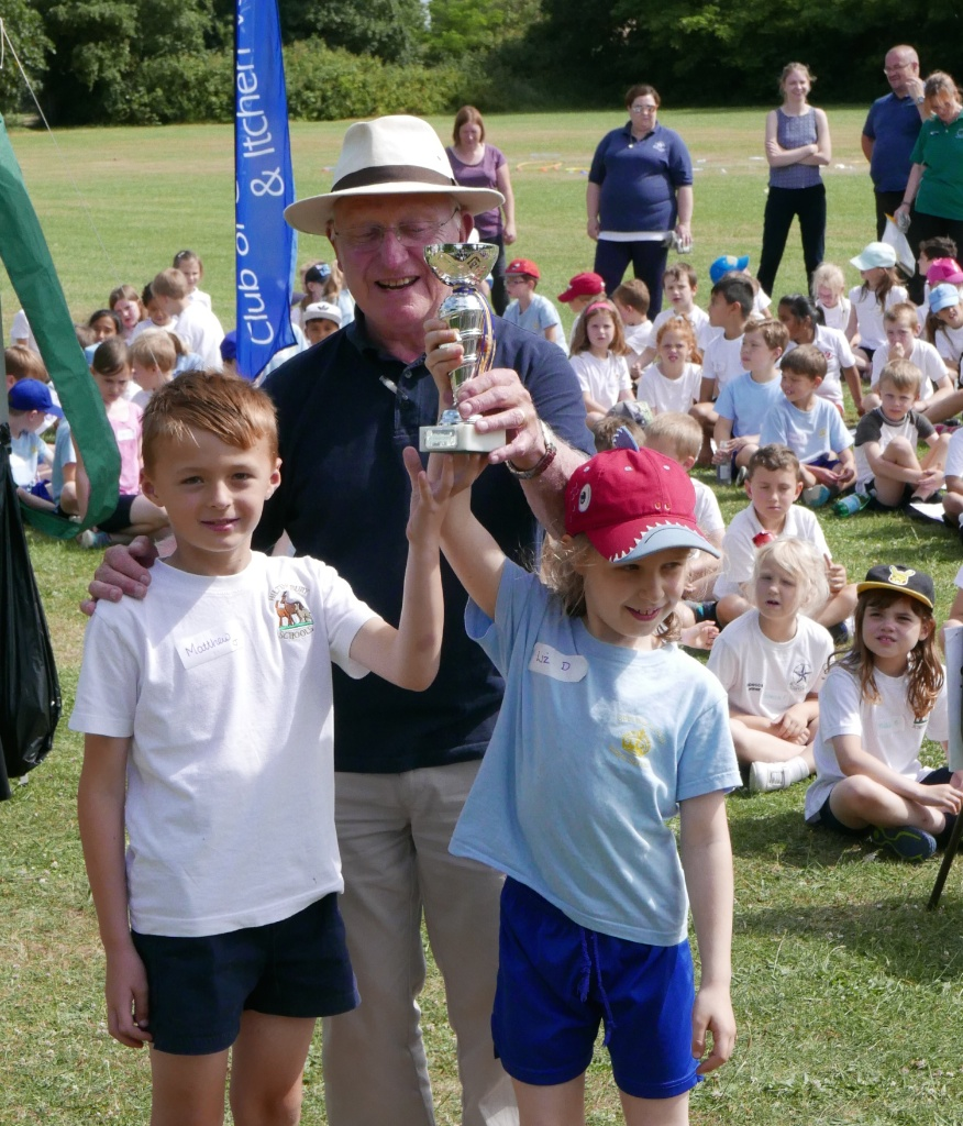 Primary School Fun Sports Day  - Rotary Community Service leader presents the trophy.