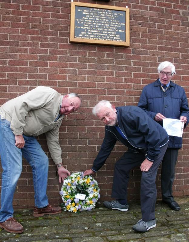 Visit to Horwich - Presidents of Douglas and Horwich Rotary Clubs place the 56th Anniversary wreath at the Transmitter Station at Winter Hill.