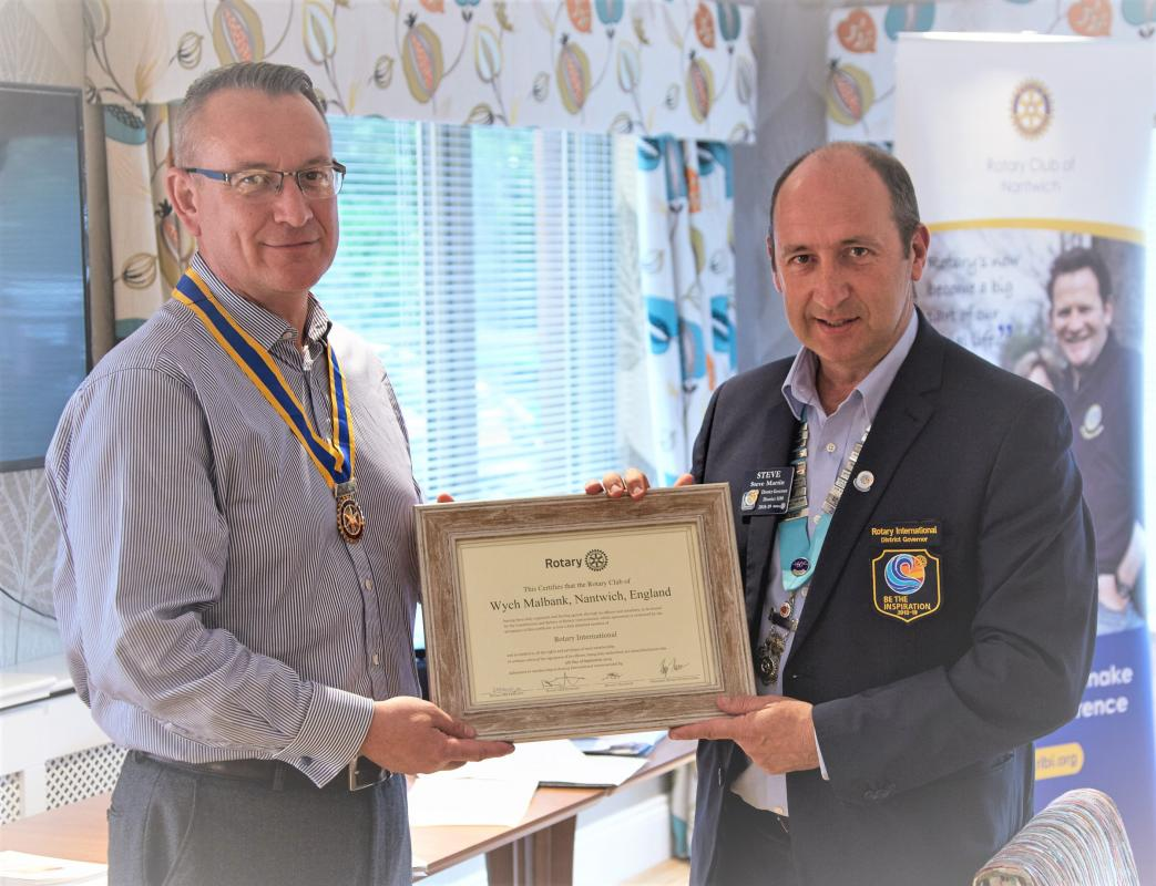 Chartering of Wych-Malbank Nantwich Rotary Club - DG Steve Martin Presenting Charter to President John Poulson