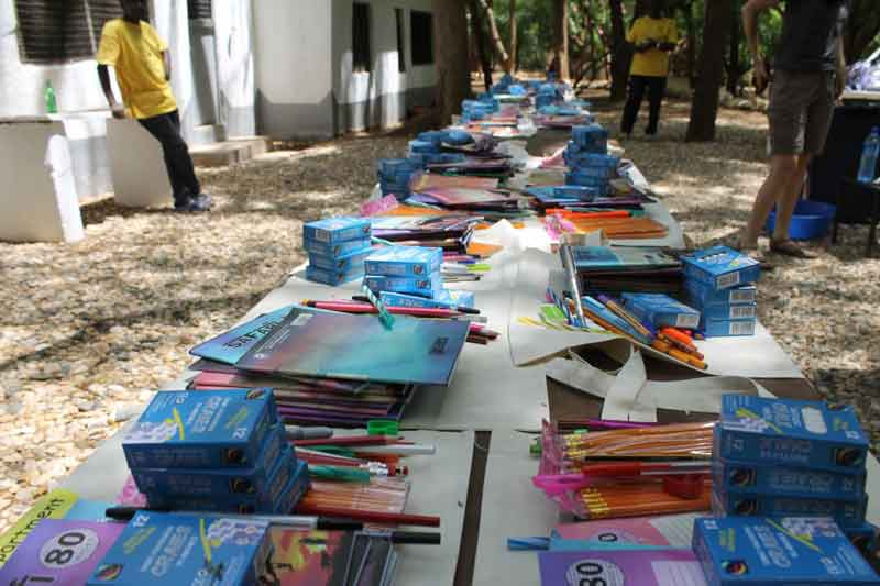 Yellowmen Visit to Kenya - March 2018 - Books and material sorted for schools