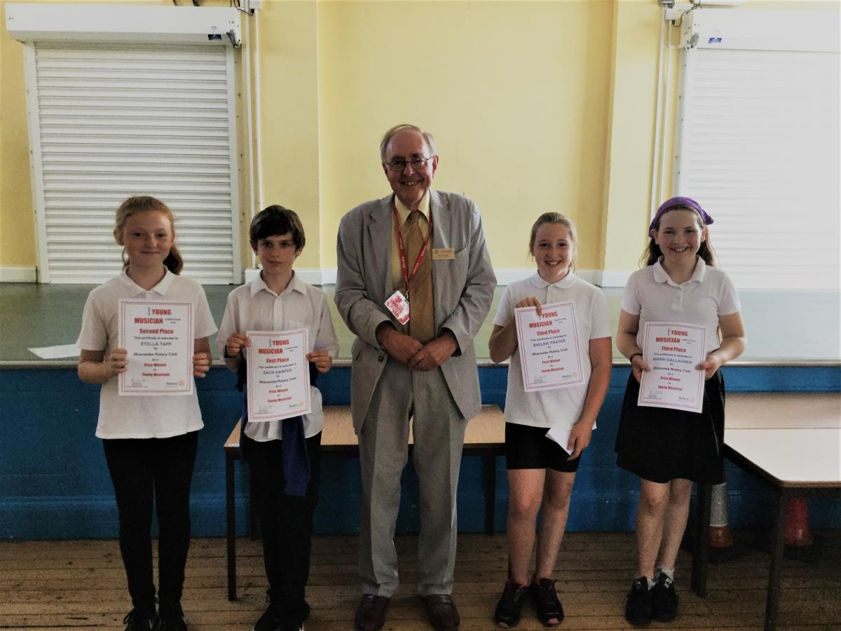 A Busy Youth Committee - Ian Stuart presenting to the Young musician award winners at Ilfracombe Junior School