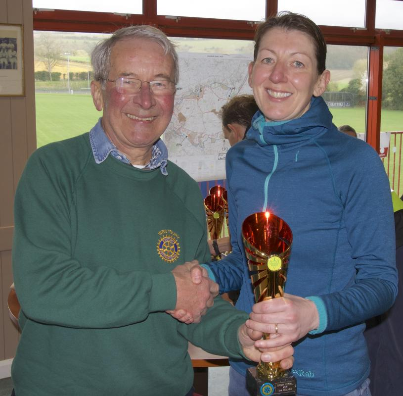 Imber Ultra Marathon - The President, David Harris, presents a trophy to the Winner of the Lady's race.  Still smiling after her ordeal - the run that is not meeting David!