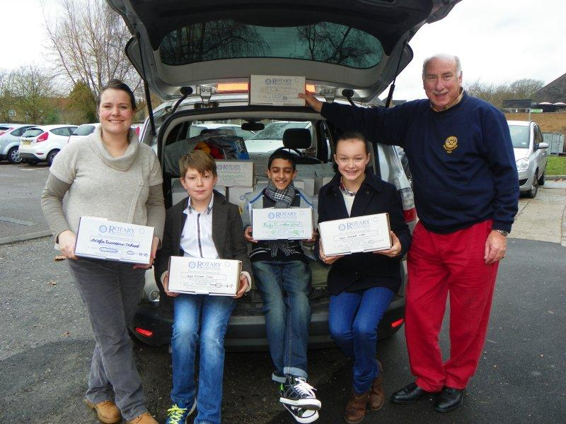 Rotary Shoebox Collections - 2017 - Rotarian Andrew collecting from the students