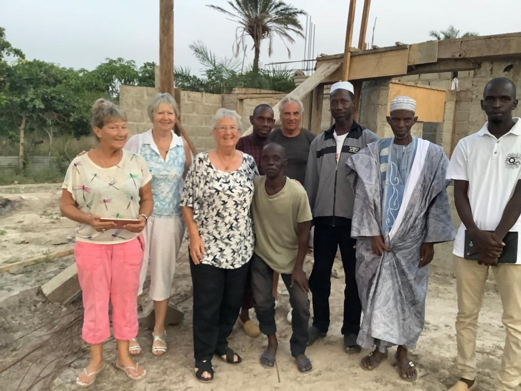 Bantaba Project  - Rose Dawson, Irene Childerley, Hazel Dawson and John Martin with the Madiana Village Development Committee and Abou Keita. The village chief is in the blue robes.