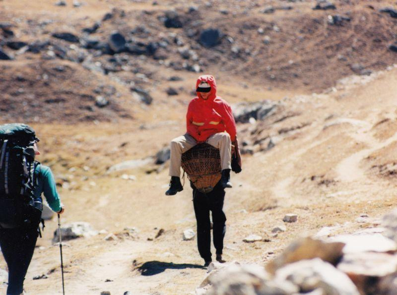 Jean Turner, Climbing Expedition.  - This man is being carried down by a sherpa.