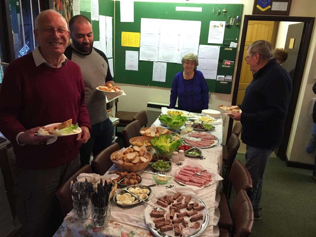 Newbury Bowling Club - Rotary and Bowling Club members start to enjoy the tea prepared by Lydia and Gill.