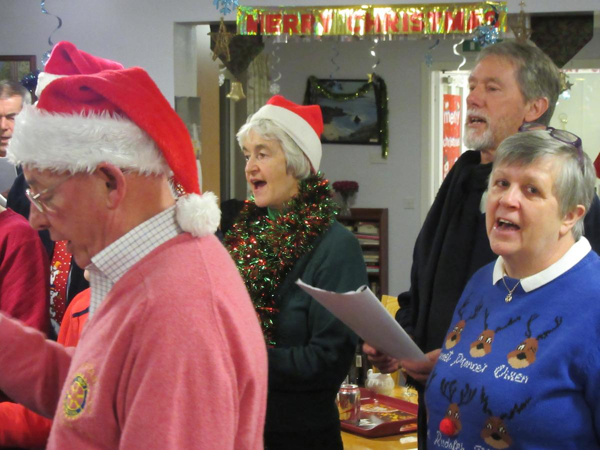Community & Vocational - Rotarians and Friends go around nursing homes etc to sing carols