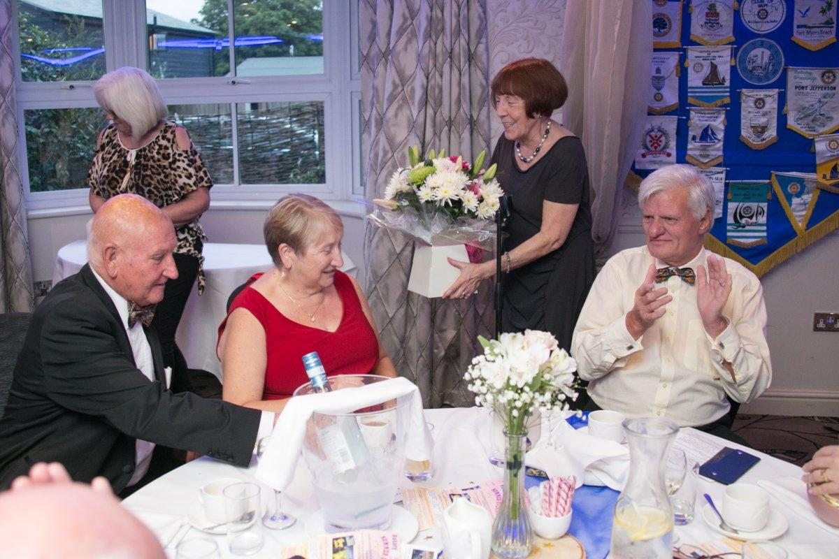 44th Charter Celebration Dinner & Handover - Senga presents a bouquet of flowers to Edna