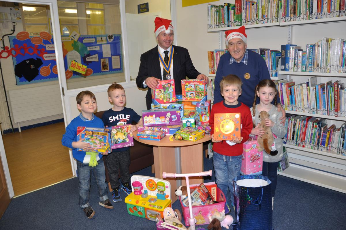The Local Community - School children collect toys for those less fortunate at Christmas