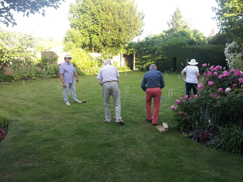 Having Fun - Members learning that croquet can get really mean!