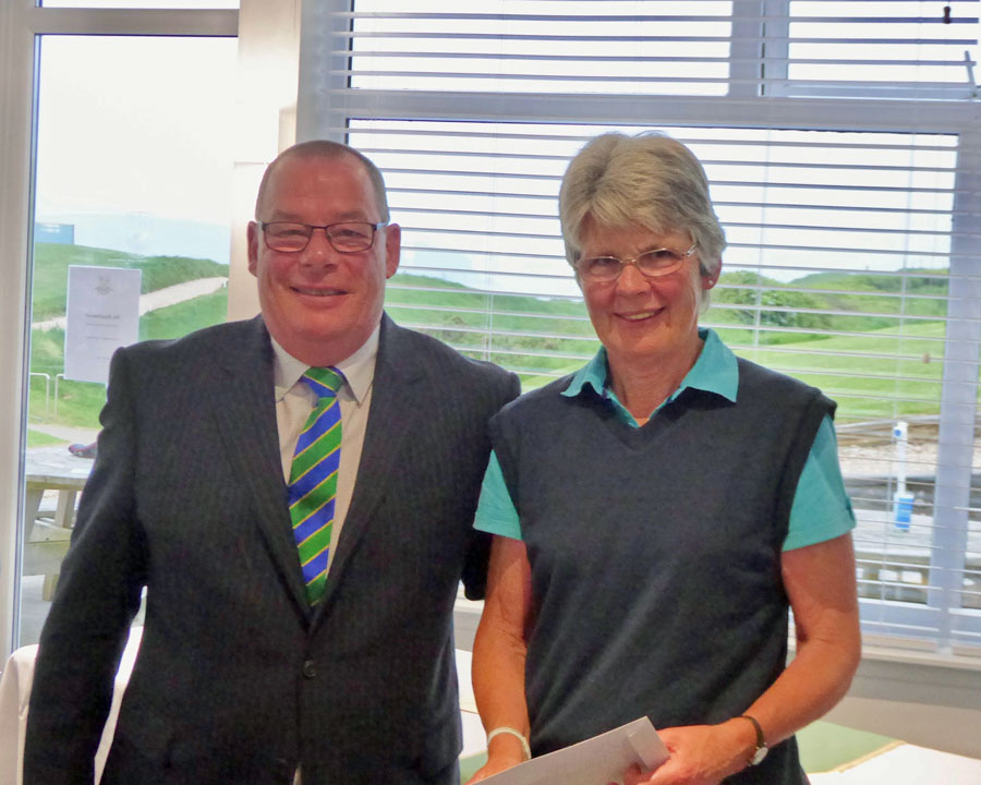 2018 Charity Golf Day - Harry Cattell Thurlestone Golf Club captain and Sally Huntley nearest the Pin on hole 6 and scoring a two