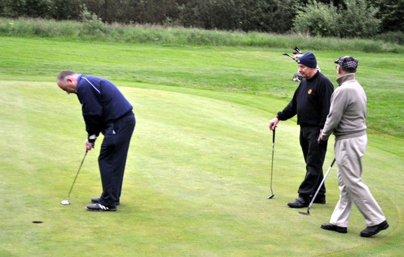 Outside visit - Golf Evening 2012 - Ian putting with Terry and Bill looking on