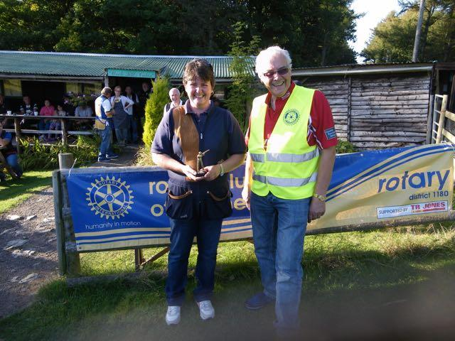 2015 Annual Clay Pigeon Shoot 26th September 2015 - Sioned Jones receives her prize as Top Lady in the competition from President Clive