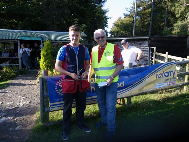 2015 Annual Clay Pigeon Shoot 26th September 2015 - Huw Jones receiving his prize as Top Junior from President Clive McGregor
