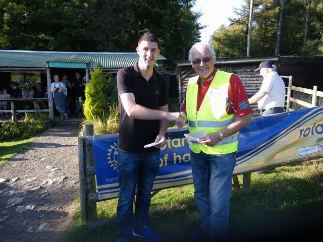 2015 Annual Clay Pigeon Shoot 26th September 2015 - President Clive McGregor presenting Sion Jones on winning Top Gun at the shoot