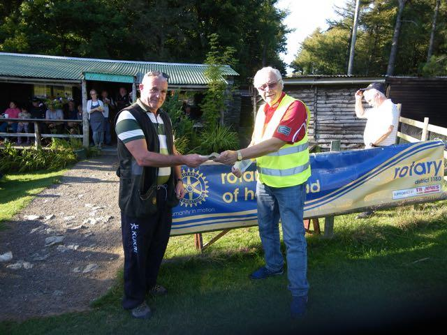 2015 Annual Clay Pigeon Shoot 26th September 2015 - David Taverner receives his prize as reserve Top Gun from President Clive