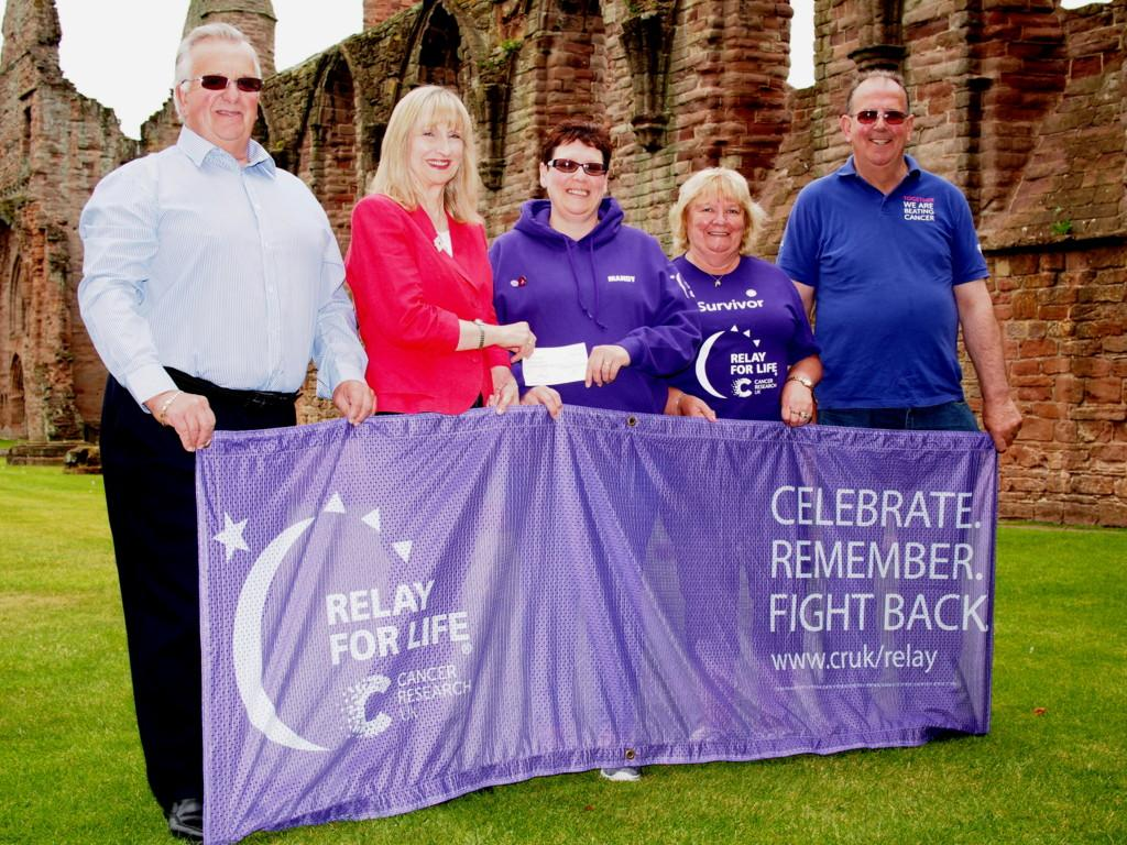 Cheque presentations - L-R Harry Simpson (Rotary), Sue Simpson (Inner Wheel) Mandy Ritchie (Survivors) Dorothy Simpson (Survivors) Ian Angus (Relay for Life)